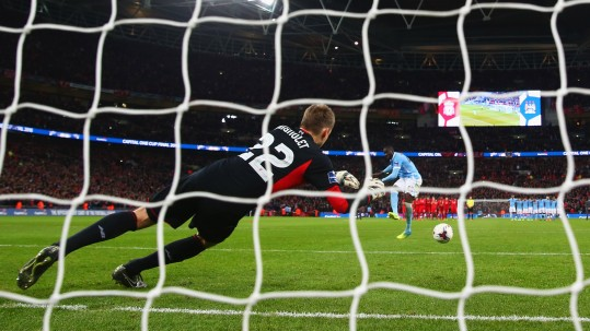LONDON, ENGLAND - FEBRUARY 28:  Yaya Toure of Manchester City scores the winning penalty past goalkeeper Simon Mignolet of Liverpool to win the shoot out during the Capital One Cup Final match between Liverpool and Manchester City at Wembley Stadium on February 28, 2016 in London, England.  (Photo by Michael Steele/Getty Images)