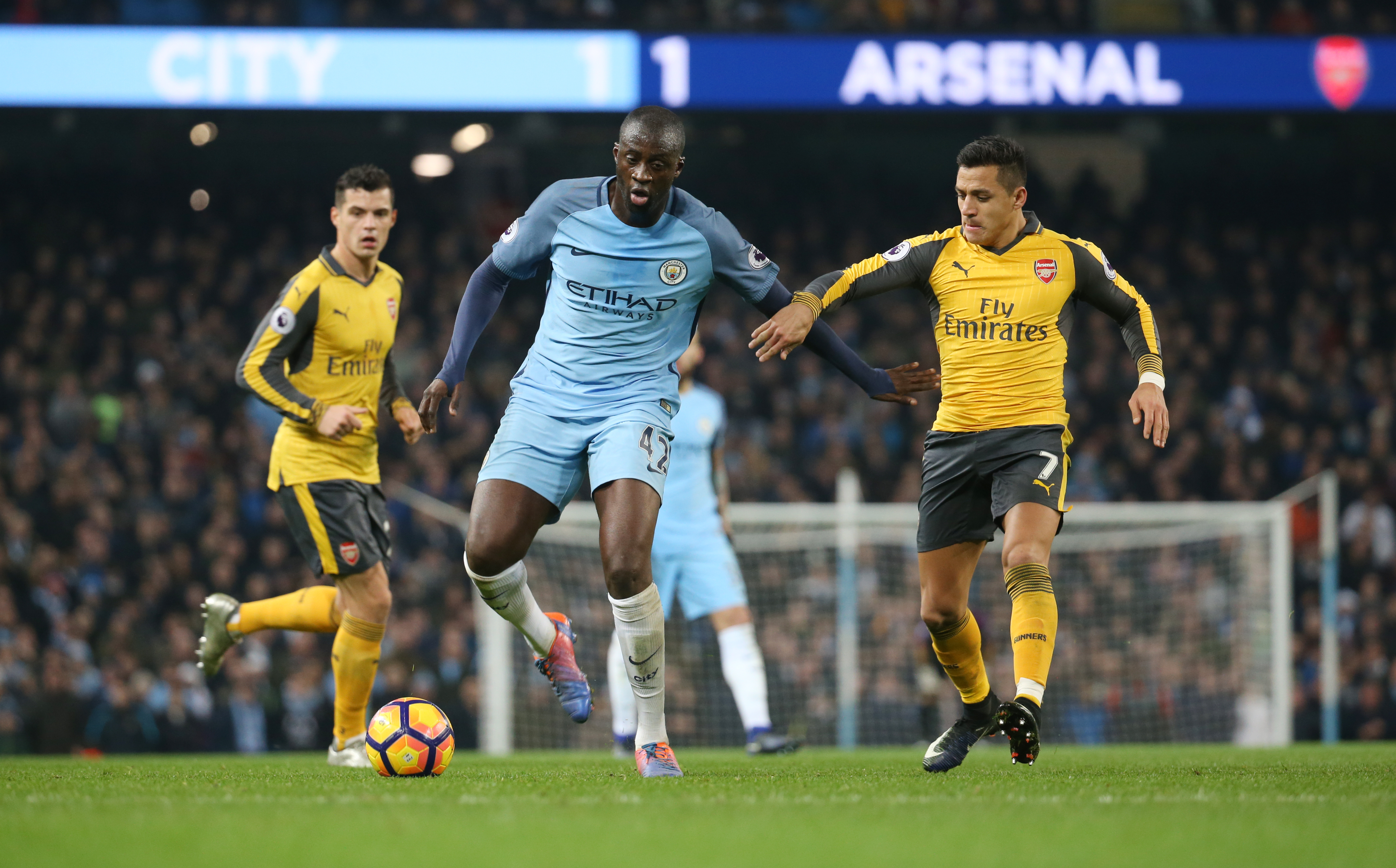 Manchester City's Yaya Toure and Arsenal's Alexis Sanchez in action