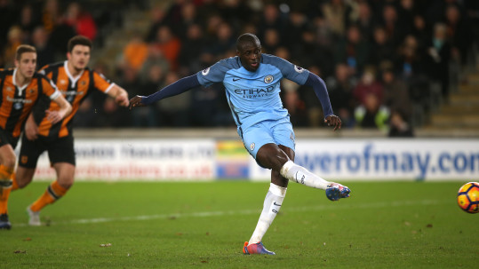 Manchester City's Yaya Toure scores his side's first goal of the game from the penalty spot during the Premier League match at the KCOM Stadium, Hull.