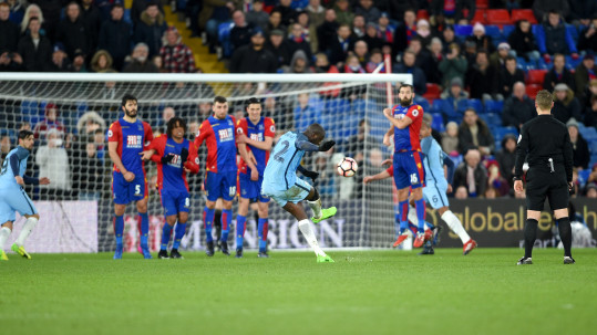 Manchester City's Yaya Toure scores his side's third goal of the game from a free kick during the Emirates FA Cup, fourth round match at Selhurst Park, London.